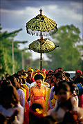 Musicians lead a wedding procession on Lombok, an island in the vast Indonesian archipelago, where Muslim and Hindu traditions are intertwined. Beneath a canopy, the bride walks with female attendants to the groom's home, where a Muslim cleric will perform the relatively short Islamic ceremony.  © Steve Raymer / ALL RIGHTS RESERVED
