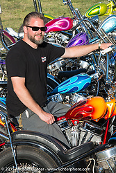 """SoCal painter """"Harpoon""""  with a very colorful grouping of custom choppers that he painted on day two of the Born Free Vintage Chopper and Classic Motorcycle Show at the Oak Canyon Ranch in Silverado, CA. USA. Sunday, June 29, 2014.  Photography ©2014 Michael Lichter."""