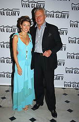 DANNI MINOGUE and PER NEUMAN MD Estee Lauder UK at a party to celebrate Pamela Anderson's new role as spokesperson and newest face of the MAC Aids Fund's Viva Glam V Campaign held at Home House, Portman Square, London on 21st April 2005.<br /><br />NON EXCLUSIVE - WORLD RIGHTS