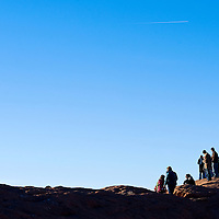 120112       Cable Hoover<br /> <br /> Spectators line the tops of the sandstone bluffs to watch Saturday's launch during the Red Rock Balloon Rally at Red Rock Park.