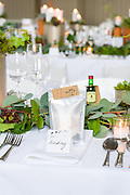 Products and serviecs offered by wedding planning and prop hire company 'Get Knotted'. The company, run by Lindsey Hunter from her base in the Scottish Borders, can design, style organise and provide all the props and items needed for a wedding. These images were taken as the team prepare St Boswells hall for a wedding, using plant pots made from recycled piant tins, succulents, an up-cycled bar and larch and spruce hanging from the roof.