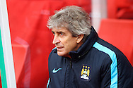 Manchester City Manager Manuel Pellegrini looks on prior to kick off. Barclays Premier league match, Stoke city v Manchester city at the Britannia Stadium in Stoke on Trent, Staffs on Saturday 5th December 2015.<br /> pic by Chris Stading, Andrew Orchard sports photography.