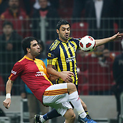 Galatasaray's Arda TURAN (L) and Fenerbahce's Bekir IRTEGUN (R) during their Turkish superleague soccer derby match Galatasaray between Fenerbahce at the Turk Telekom Arena in Istanbul Turkey on Friday, 18 March 2011. Photo by TURKPIX