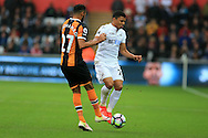 Jefferson Montero of Swansea city is challenged by Ahmed Elmohamady of Hull city. Premier league match, Swansea city v Hull city at the Liberty Stadium in Swansea, South Wales on Saturday 20th August 2016.<br /> pic by Andrew Orchard, Andrew Orchard sports photography.