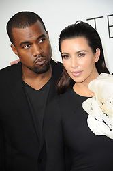 """File photo of Kim Kardashian and Kanye West backstage of Stephane Rolland Fall-Winter 2012-2013 Haute Couture collection show during Haute-Couture Fashion Week held at the Cite de l'Architecture in Paris, France, on July 3, 2012. Kim Kardashian West spoke out about Kanye West's bipolar disorder Wednesday, three days after the rapper delivered a lengthy monologue at a campaign event touching on topics from abortion to Harriet Tubman, and after he said he has been trying to divorce her.Kardashian West said in a statement posted in an Instagram Story that she has never spoken publicly about how West's bipolar disorder has affected their family because she is very protective of their children and her husband's """"right to privacy when it comes to his health."""" Photo by Nicolas Briquet/ABACAPRESS.COM"""