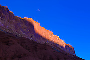Moonrise over evening light on the Waterpocket Fold, Capitol Reef National Park, Utah