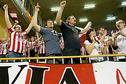 Fans of Asseco Resovia Rzeszow celebrate after volleyball match between ACH Volley (SLO) and Asseco Resovia Rzeszow (POL) at 2nd Leg of Semifinals of CEV Men Volleyball Cup 2011/2012, on March 17, 2012 in Arena Tivoli, Ljubljana, Slovenia.  (Photo By Urban Urbanc / Sportida.com)