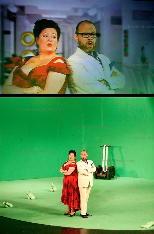 Picture shows : Karen Cargill as Isabella and  Adrian Powter as Taddeo..Picture  ©  Drew Farrell Tel : 07721 -735041..A new Scottish Opera production of  Rossini's 'The Italian Girl in Algiers' opens at The Theatre Royal Glasgow on Wednesday 21st October 2009..(Soap) opera as you've never seen it before..Tonight on Algiers.....Colin McColl's cheeky take on Rossini's comic opera is a riot of bunny girls, beach balls, and small screen heroes with big screen egos. Set in a TV studio during the filming of popular Latino soap, Algiers, the show pits Rossini's typically playful and lyrical music against the shoreline shenanigans of cast and crew. You'd think the scandal would be confined to the outrageous storylines, but there's as much action off set as there is on.....Italian bass Tiziano Bracci makes his UK debut in the role of Mustafa. Scottish mezzo-soprano Karen Cargill, who the Guardian called a 'bright star' for her performance as Rosina in Scottish Opera's 2007 production of The Barber of Seville, sings Isabella..Cast .Mustafa...Tiziano Bracci.Isabella..Karen Cargill.Lindoro...Thomas Walker.Elvira...Mary O'Sullivan.Zulma...Julia Riley.Haly...Paul Carey Jones.Taddeo...Adrian Powter..Conductors.Wyn Davies.Derek Clarke (Nov 14)..Director by Colin McColl.Set and Lighting Designer by Tony Rabbit.Costume Designer by Nic Smillie..New co-production with New Zealand Opera.Production supported by.The Scottish Opera Syndicate.Sung in Italian with English supertitles..Performances.Theatre Royal, Glasgow - October 21, 25,29,31..Eden Court, Inverness - November 7. .His Majesty's Theatre, Aberdeen  - November 14..Festival Theatre,Edinburgh - November 21, 25, 27 ...Note to Editors:  This image is free to be used editorially in the promotion of Scottish Opera. Without prejudice ALL other licences without prior consent will be deemed a breach of copyright under the 1988. Copyright Design and Patents Act  and will be subject to payment or legal action, where appropriate..Furthe