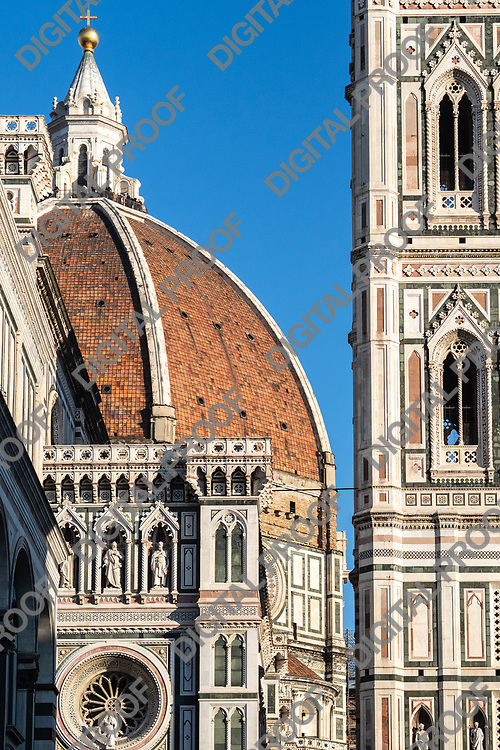Firenze, Tuscany Italy - December 30, 2018 Detail of Giotto's Bell Tower and the Florence Dome in a sunny day - vertical crop