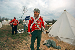 11 January 2015. New Orleans, Louisiana. <br /> Bicentennial reenactment of the Battle of New Orleans in Chalmette. <br /> Phillip Dye of the Royal Welsh Fuseliers  of the British forces prepares to re-enact the January 8th, 1815 disastrous battle against American foes marking the 200th anniversary of the Battle of New Orleans in Chalmette. Despite heavily outnumbering the Americans, the British suffered over 2,000 casualties, with many senior officers amongst the dead and injured compared to the Americans who suffered a mere 70 by comparison. The American victory was hailed as miracle.<br /> Photo; Charlie Varley/varleypix.com