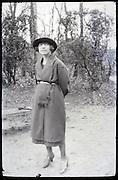 woman standing looking upwards 1900s
