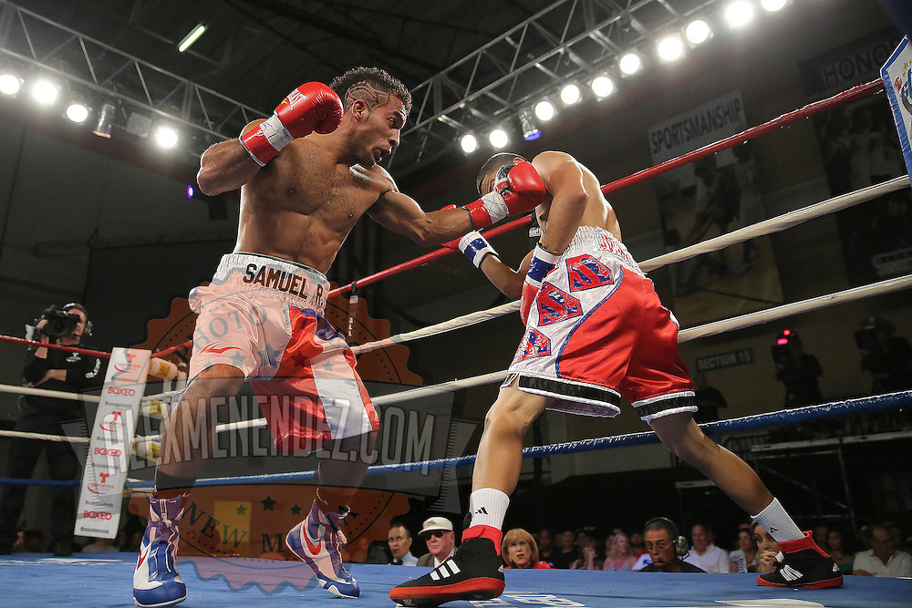 """Samuel Rodriguez (left) fights Jayron Santiago during a """"Boxeo Telemundo""""  boxing match at the Kissimmee Civic Center on Friday, July 18, 2014 in Kissimmee, Florida. Rodriguez won the bout. (AP Photo/Alex Menendez)"""
