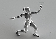 Nano sculptures are the same scale as a human sperm<br /> <br /> Size matters. Anamophic artist Jonty Hurwitz's new sculpture series recreates the smallest human form ever at 20x80x100 microns, or roughly the scale of a human sperm. According to Hurwitz's website, the size of these sculptures approximately equals the amount your fingernails grow every 5 or 6 hours. These tiny art works are too small to be seen by the naked eye!<br /> marking a breakthrough in the capabilities of technology and science in relationship to creativity and craftsmanship, london-based artist jonty hurwitz has created the smallest known, human-shaped sculptures in the world –  completely invisible to the human eye. 'trust' and 'cupid and psyche: the first kiss' span about the same scale as a sperm, and can only be perceived on the screen of powerful scanning electron microscope.  how can you ever know that this sculpture really exists? 'your only way to engage with it is through a screen, and a mouse separating you and the art via a vacuum and a series of mathematically mind-blowing quantum processes that shower the art with particles to map its contours', hurwitz explains.<br /> the nano sculpture is created using 3D printing technology and a technique called multiphoton lithography, which works to create super-small features within a photosensitive material. ultimately the pieces are created using the physical phenomenon of two photon absorption: 'art, literally created with quantum physics', describes hurwitz. 'if you illuminate a UV-sensitive polymer with ultra violet light, it solidifies wherever it was irradiated in a kind of crude lump. some of you may have experienced a polymer like this first hand at the dentist when your filling is glued in with a UV light. if however you use longer wavelength intense light, and focus it tightly through a microscope, something wonderful happens: at the focus point, the polymer absorbs two photons and responds as if it had been illuminated by UV l