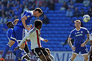 Cardiff City's Sean Morrison (l) heads in to score Cardiff's 1st goal to equalise at 1-1.  EFL Skybet championship match, Cardiff city v Brentford at the Cardiff City Stadium in Cardiff, South Wales on Saturday 8th April 2017.<br /> pic by Carl Robertson, Andrew Orchard sports photography.