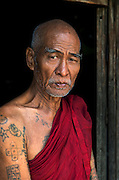 A buddhist monk devotes himself to preserving a decaying old teak monastery, Mandalay