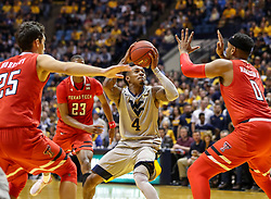 Feb 26, 2018; Morgantown, WV, USA; West Virginia Mountaineers guard Daxter Miles Jr. (4) shoots in the lane during the second half against the Texas Tech Red Raiders at WVU Coliseum. Mandatory Credit: Ben Queen-USA TODAY Sports