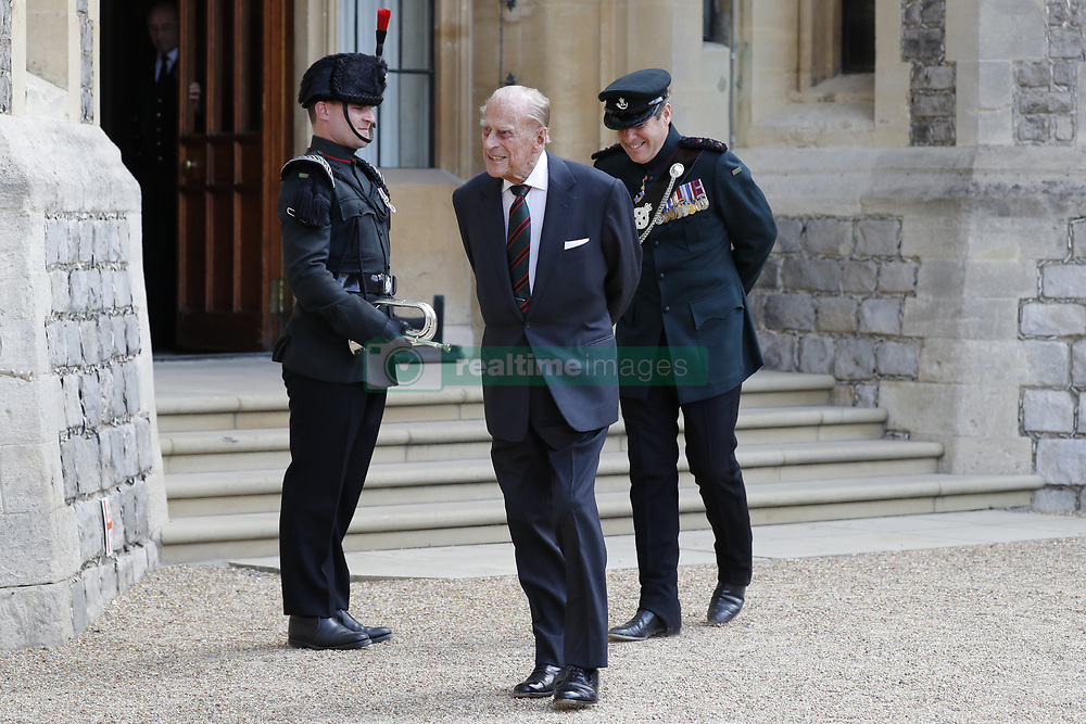File photo dated 22/07/2020 of the Duke of Edinburgh at Windsor Castle flanked by Assistant Colonel Commandant, Major General Tom Copinger-Symeas (right), during a ceremony for the transfer of the Colonel-in-Chief of the Rifles from the Duke to the Duchess of Cornwall. The Duke of Edinburgh has died, Buckingham Palace has announced. Issue date: Friday April 9, 2020.