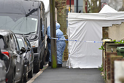 © Licensed to London News Pictures. 19/03/2020.  London UK: Forensic officers at a murder investigation after a female in her twenties was found in Altmore avenue, East Ham, east London with fatal stab injuries. Emergency services were called at around 12.45am  this morning but the victim was pronounced dead in hospital    , Photo credit: Steve Poston/LNP
