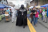 Pine Bush, New York - A man dressed as Darth Vader walks down Main Street during the Pine Bush UFO Fair on  on April 26, 2014.