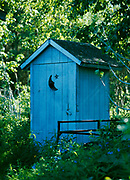 Baby blue outhouse with crescent moon and star, Bissell Homestead, Chickaloon, Alaska.