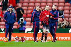 Wayne Rooney of Manchester United shares a joke with Assistant Manager Ryan Giggs during the warm up - Mandatory byline: Rogan Thomson/JMP - 26/12/2015 - FOOTBALL - Britannia Stadium - Stoke, England - Stoke City v Manchester United - Barclays Premier League - Boxing Day Fixture.