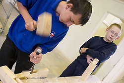 Woodwork student learning how to make mortice and tenon joint,