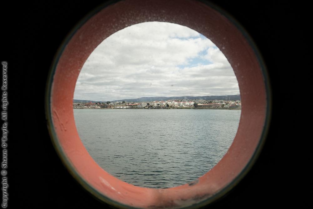 Porthole view of Punta Arenas, Chile