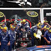 NASCAR Spring Cup driver Aric Almirola (43) celebrates with his crew in Gatorade Victory Lane after winning the 56th Annual NASCAR Coke Zero 400 race at Daytona International Speedway on Sunday, July 6, 2014 in Daytona Beach, Florida.  (AP Photo/Alex Menendez)