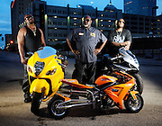 Premier bike builder Tommy Bolton (center) of Tombo Racing with his Suzuki race bikes.
