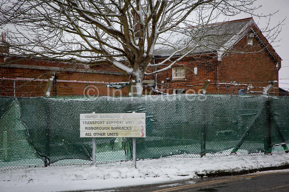 Snow falling at Napier Barracks, on the 7th of February 2021, Folkestone, United Kingdom. Men are locked up in accommodation inside Napier Barracks due to COVID-19 restrictions, Over 100 asylum seekers are being kept at Napier Barracks in unsuitable, cold accommodation, they are experiencing mental health issues as well as being vulnerable to health conditions including COVID-19. 3 people living inside the barracks have attempted suicide in 2021 already.
