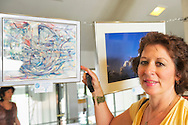 Artist KATHERINE TRUNK by her Moon Art painting at Science Exploration Moon Day, by Long Island Fringe Festival 5, and hosted by Tackapausha Museum and Preserve, at Seaford, New York, USA, on 20th July 2013.