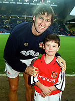 Arsenal captain Tony Adams with the mascot before the match. Leeds United v Arsenal, F.A.Carling Premiership, 26/11/2000. Credit Colorsport / Stuart MacFarlane
