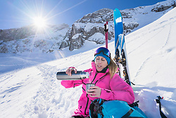 Woman skier on hot teak break, Bavaria, Germany, Europe