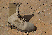 A military boot lies discarded on the ground near to Libyan Army armoured vehicles that were destroyed by NATO airstrikes in the city of Ajdabiyah...Ajdabiyah 26 March 2011