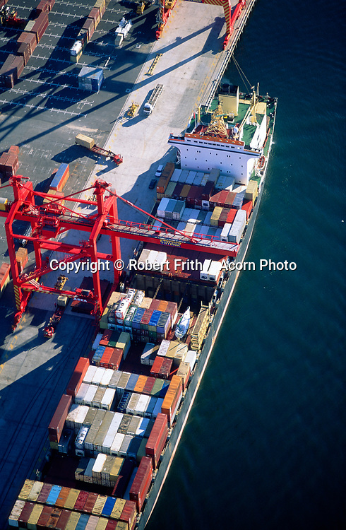 Aerial view of a container ship being loaded by a crane at the Fremantle Port.. aerial view of container ship being loaded by crane at Fremantle Port