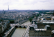 City view from Notre Dame cathedral, Paris, France in 1970 looking over he River Seine towards the Eiffel Tower