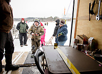 Bringing in a catch to be measured during Belknap County Sportman's Club Ice Fishing event.  (Karen Bobotas Photographer)