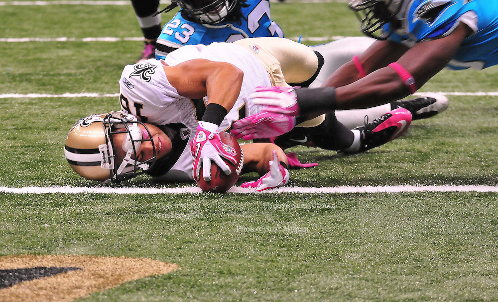 """New Orleans Saints WR Lance Mooore 16 runs towards the endzone then takes a hard hit and fumbles at the goal lineduring the game against the Caoliina Panthers. 3,2010 prior to the Saints game against the Carolina Panthers. The NFL has gone """"Pink"""" for October in honor of Breast Cancer Awareness. The Saints went on to win 16-14. John Carney kicked three field goals to help the Saints win. PHOTO©SuziAltman.com"""
