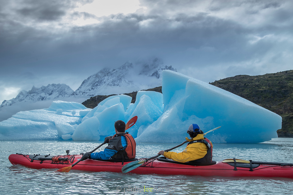Kayak by ice berg in Grey Lake in Torres del Paine National Park, Chile