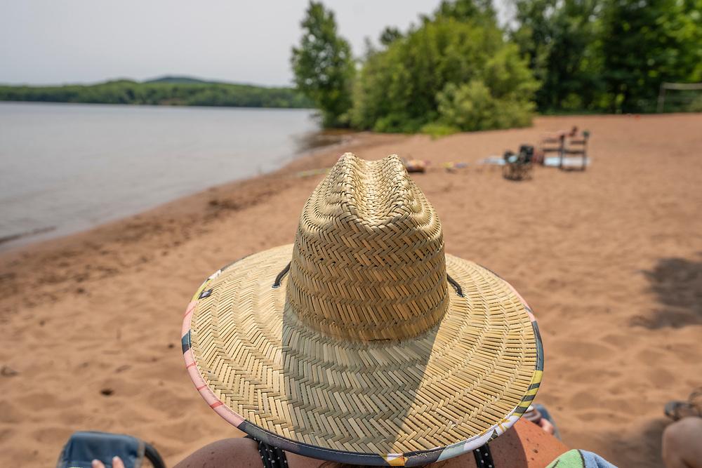 Beach scene at Perkins Park on Lake Independence at Big Bay, Michigan.