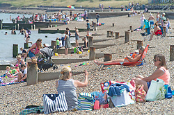 ©Licensed to London News Pictures 06/08/2020     Minster-on-sea, UK. Hot sunny weather today as people visit the beach at Minster-on-sea on the Isle of sheppey in Kent. Photo credit: Grant Falvey/LNP