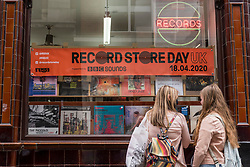 © Licensed to London News Pictures. 29/08/2020. LONDON, UK. Customers outside Sounds of the Universe. Analogue music fans visit independent record shops in Soho to celebrate vinyl music on the rescheduled 13th Record Store Day, originally planned for April, but postponed due to the coronavirus pandemic.  Over 200 independent record shops across the UK come together annually to celebrate the unique culture of analogue music with special vinyl releases made exclusively for the day.  Sales of vinyl have risen, with 4.3m records sold in the UK during 2019, more than a 12-fold increase on the levels seen in 2011. Photo credit: Stephen Chung/LNP