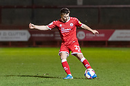 Crawley Town defender Nicholas Tsaroulla (#25) crosses the ball during the EFL Sky Bet League 2 match between Crawley Town and Walsall at The People's Pension Stadium, Crawley, England on 16 March 2021.