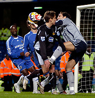 Photo: Ed Godden/Sportsbeat Images.<br />Chelsea v Wigan Athletic. The Barclays Premiership. 13/01/2007. Wigan's Andreas Johansson colides with Chelsea keeper Henrique Hilario.