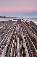 Dawn on the rocky coast with layered flysch, coast in the Basque Country, Spain<br /> <br /> Morgendämmerung an der Felsküste mit geschichtetem Flysch