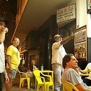 Locals watch the football at a bar in Copacabana Beach, Rio de Janeiro,  Brazil. 30th September 2010. Photo Tim Clayton
