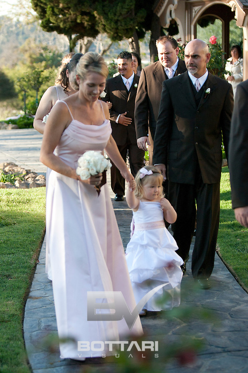 Amy Thesson and Donovan Miles celebrate their wedding day together on October 10, 2010 in San Diego, CA. Amy got ready before her wedding at the Sheraton San Diego Hotel and Marina. The ceremony took place at the Little Chapel of the Roses at Glen Abbey Chapel in Chula Vista - Bonita, CA.