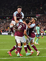 Football - 2021 / 2022 Premier League - West Ham United vs Leicester City - London Stadium - Monday 23rd August 2021<br /> <br /> West Ham United's Michail Antonio (hidden) congratulated after scoring his sides 4th goal as Declan Rice jumps in the air<br /> <br /> COLORSPORT/Ashley Western