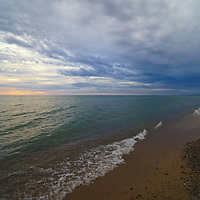 """""""Moment to Dream"""" <br /> <br /> A peaceful moment of convergence of clouds along Lake Michigan near South Haven."""