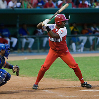 15 February 2009: Nava of the Orientales is seen at bat during a training game of Cuba Baseball Team for the World Baseball Classic 2009. The national team is pitted against itself, divided in two teams called the Occidentales and the Orientales. The Orientales win 12-8, at the Latinoamericano stadium, in la Habana, Cuba.